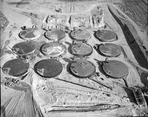 Cold War-era waste tanks under construction at Hanford. Source: DOE