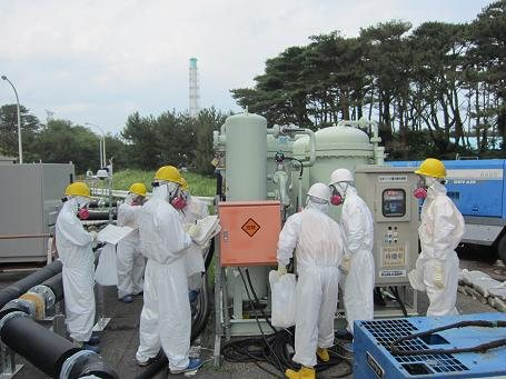 Workers at an emergency nitrogen gas separator July 5. Source: TEPCO
